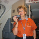 Flight attendant sporting Crossroads T-shirt